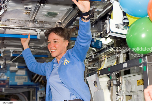 In Earth Orbit - July 6, 2006 -- Astronaut Lisa M. Nowak, STS-121 mission specialist, smiles at a crewmate in the Destiny laboratory of the International Space Station..Credit: NASA via CNP