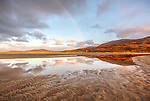Isle of Lewis and Harris, Scotland: A rainbow and the expansive sand bay of Luskentyre beach on South Harris Island