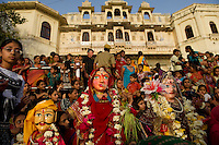 The Gangaur festival is celebrated in Rajasthan in worship of Lord Shiva and Gauri, seeking blessings of conjugal bliss. Wooden idols of Shiva and Gauri are decorated during this festival and are brought to the lake for immersion. Image have taken just before sunset at the Gangaur Ghat in Udaipur, Rajasthan.