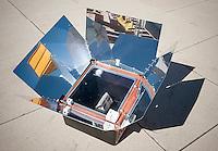 A solar oven cooks popcorn in New York on Sunday, October 12, 2014. (© Richard B. Levine)