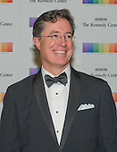 Stephen Colbert arrives for the formal Artist's Dinner honoring the recipients of the 38th Annual Kennedy Center Honors hosted by United States Secretary of State John F. Kerry at the U.S. Department of State in Washington, D.C. on Saturday, December 5, 2015. The 2015 honorees are: singer-songwriter Carole King, filmmaker George Lucas, actress and singer Rita Moreno, conductor Seiji Ozawa, and actress and Broadway star Cicely Tyson.<br /> Credit: Ron Sachs / Pool via CNP