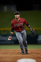 AZL Dbacks Sergio Gutierrez (9) underhands a ball to the pitcher covering first base during an Arizona League game against the AZL Cubs 2 on June 25, 2019 at Sloan Park in Mesa, Arizona. AZL Cubs 2 defeated the AZL Dbacks 4-0. (Zachary Lucy/Four Seam Images)