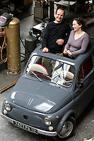 The owners of the converted factory in their equally retro Fiat Cinquecento