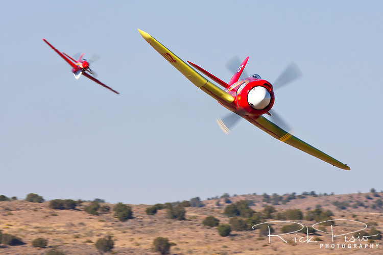 "Mike Brown in the highly modified Hawker Sea Fury ""September Fury"" leads Dan Martin in ""Dago Red"" during an Unlimited Air Race while competing in the 2008 Reno Championship Air Races."