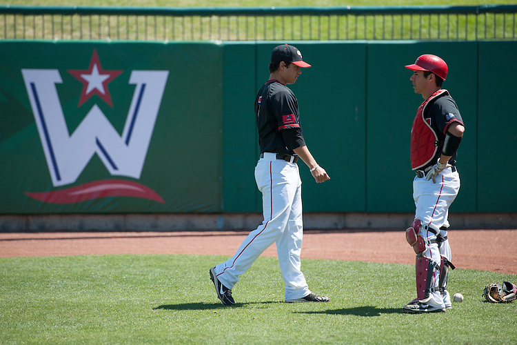 May 23, 2013; Stockton, CA, USA; Gonzaga Bulldogs pitcher/infielder Marco Gonzales (7, left) and catcher Travis Forbes (23, right) during the WCC Baseball Championship at Banner Island Ballpark.