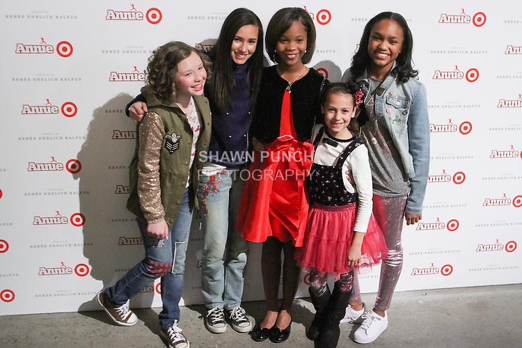 Quevenzhane Wallis (Center) poses with the cast of Annie at the Annie For Target collection celebration and pop-up shop at Stage 37 in New York City on November 4, 2014.