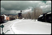 Chama yards in snow. Coaling tower in background - #483 K-36 to right.<br /> C&amp;TS  Chama, NM