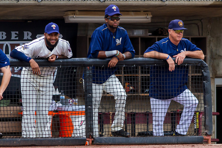 Wisconsin Timber Rattlers outfielder Domingo Santana (16), outfielder Carlos Belonis (1) and coach Bob Miscik during a Midwest League game against the Lake County Captains on July 24th, 2016 at Fox Cities Stadium in Appleton, Wisconsin. Lake County defeated Wisconsin 6-2. (Brad Krause/Krause Sports Photography)