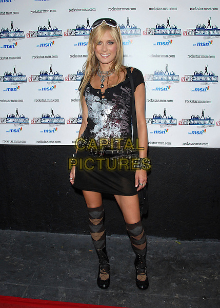 JENNY GALT.The Rockstar Supernova kick off party held at The Roxy in West Hollywood, California, USA. .July 13th, 2006.Ref: DVS.full length black skirt boots argyle socks top.www.capitalpictures.com.sales@capitalpictures.com.Supplied By Capital PIctures