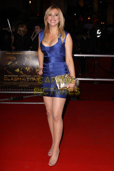 REBECCA WALSH .World Premiere of 'Clash of the Titans' at the Empire cinema, Leicester Square, London, England, March 29th 2010. arrivals full length bandage body con dress beige peep toe shoes gold clutch bag hand on hip cleavage smiling patent Christian Louboutin platform blue purple .CAP/AH.©Adam Houghton/Capital Pictures.