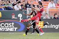 D.C. United forward Lionard Pajoy (16) goes against Chicago Fire defender Austin Berry (22) celebrates his score with teammates. D.C. United defeated The Chicago Fire 4-2 at RFK Stadium, Wednesday August 22, 2012.