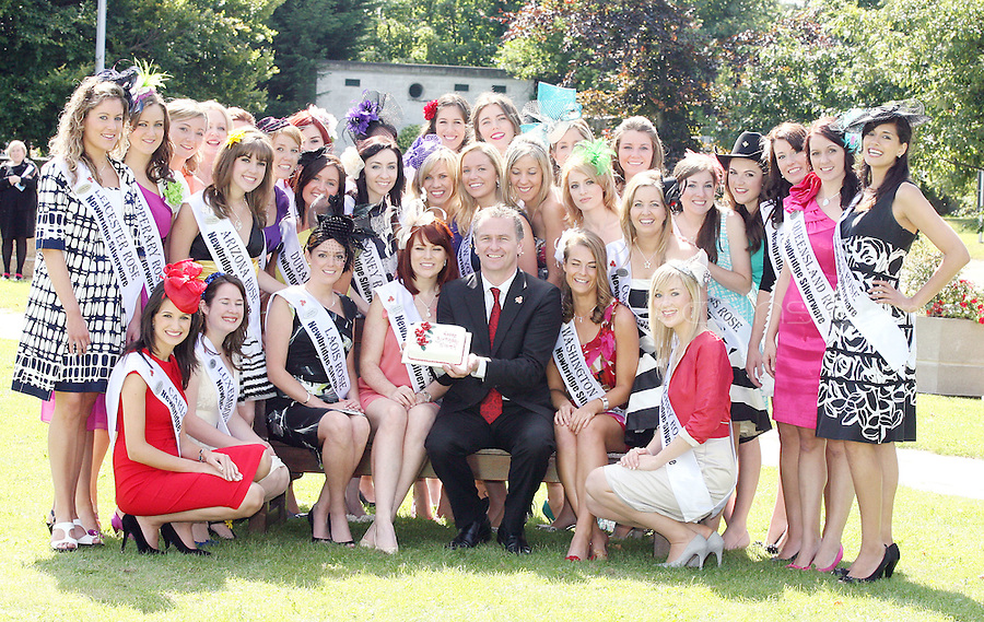 17/8/2010. 2010 Rose of Tralee visit RTE. Dáithí O Sé is pictured holding a birthday cake for the Dublin Rose Niamh Sherlock with 32 Irish and International Roses at the RTÉ studios in Donnybrook Dublin. The Rose of Tralee International Festival, which runs from Friday 20th to Tuesday 24th of August, culminates in the live televised International Rose Selection on RTÉ One, hosted for the first time by Dáithí O Sé. The show will be broadcast from 8pm on Monday and Tuesday the 23rd and 24th of August, with a break for the Nine O' Clock News on both nights. The show will also be streamed live around the world at www.rte.ie. Picture James Horan/Collins Photos