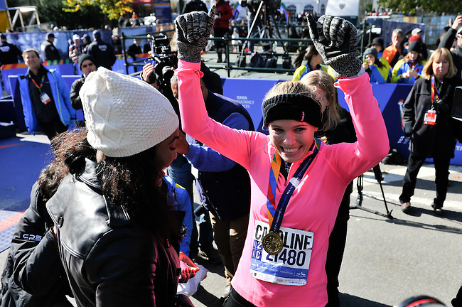 Nov 2, 2014; New York, NY, USA; Tennis star Caroline Wozniacki celebrates with close friend, tennis star Serena Williams after she finished the 2014 TCS New York City Marathon. Mandatory Credit: Derik Hamilton-USA TODAY Sports