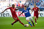 Duitsland, Gelsenkirchen, 22 september  2012.Seizoen 2012/2013.Bundesliga.Schalke 04-Bayern Munchen 0-2.Klaas Jan Huntelaar van Schalke 04 in duel om de bal met Jerome Boateng