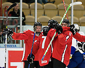 Gregory Sciaroni (HC Ambri-Piotta - Switzerland), Yannick Weber (Kitchener Rangers - Switzerland) and Janick Steinmann (EV Zug - Switzerland) celebrate. The Suisse defeated Slovakia 2-1 in a 2007 World Juniors match on January 2, 2007, at FM Mattson Arena in Mora, Sweden.