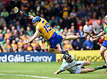 Shane O'Donnell of Clare goes flying over Nickie Quaid of Limerick after scoring his second goal during their Munster Championship semi-final at Thurles.  Photograph by John Kelly.