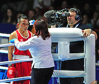 A cut on the face of Malaysia's Muhammad Alnaz Othman (red) bleeds causing his fight with Australia's Nick Cooney (blue) to go to the judges scorecards in the first round of their men's light (62kg) round of 32. <br /> <br /> Photographer Chris Vaughan/CameraSport<br /> <br /> 20th Commonwealth Games - Day 3 - Saturday 26th July 2014 - Boxing - SECC - Glasgow - UK<br /> <br /> © CameraSport - 43 Linden Ave. Countesthorpe. Leicester. England. LE8 5PG - Tel: +44 (0) 116 277 4147 - admin@camerasport.com - www.camerasport.com
