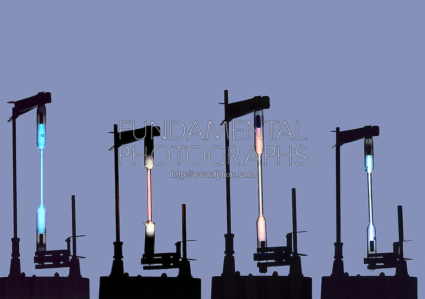EMISSION OF LIGHT FROM GASES IN DISCHARGE TUBES<br /> Mercury, Hydrogen, Nitrogen &amp; Iodine<br /> Different gases emit light of different characteristic colors upon excitation in an electrical discharge.  Mercury(bright blue), Hydrogen(magenta), Nitrogen(rose-orange), Iodine(purple to violet)