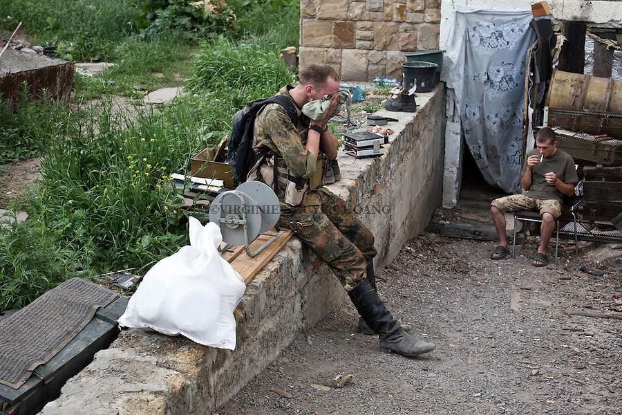 UKRAINE, Mariupol: Dan is drying his face after his mission as it's 30 degrees outside.<br /> <br /> UKRAINE, Mariupol: Dan essuie son visage apr&egrave;s sa mission. Il fait 30 degr&eacute;s &agrave; l'ext&eacute;rieur.
