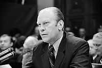 President Gerald Ford appearing at the House Judiciary Subcommittee hearing on pardoning former President Richard Nixon, Washington, D.C. 17 October 1974<br /> <br /> PHOTO : Thomas J. O'Halloran,