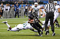 20 December 2011:  FIU wide receiver T.Y. Hilton (4) evades Marshall safety Omar Brown (31) after a reception in the first quarter as the Marshall University Thundering Herd defeated the FIU Golden Panthers, 20-10, to win the Beef 'O'Brady's St. Petersburg Bowl at Tropicana Field in St. Petersburg, Florida.