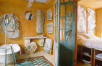 In the bathroom the frescoed classical fragments displayed against egg-yolk yellow walls were inspired by Pergamum; the bedroom is right next door and is accessed via folding glass doors