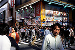 Street scene in the Akihabara neighborhood of Tokyo with advertising hoardings annoucning the newest manga comics and manga character-based video games to be released soon.  Akihabara, once the center of Tokyo technology industry, is fast being taken over my the manga comics and paraphernalia markets.