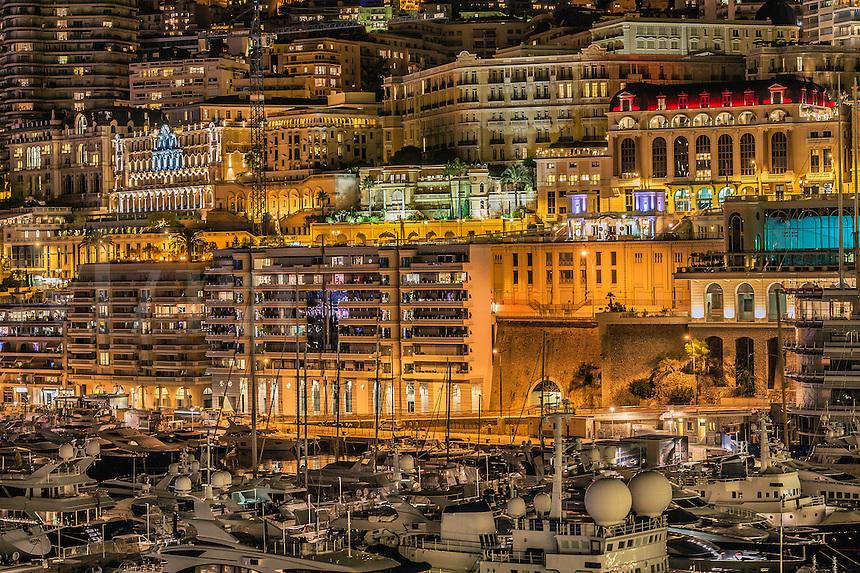 Downtown apartments and marina yachts at night, Monte Carlo, Monaco
