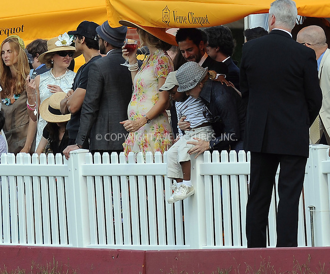 WWW.ACEPIXS.COM . . . . . ....May 30 2009, New York City....Singer Madonna and her son David Banda watch HRH Prince Harry playing in the second annual Veuve Clicquot Manhattan Polo Classic on Governors Island on May 30 2009 in New York City. The polo match was the final event of a two-day visit to New York by the Prince.....Please byline: KRISTIN CALLAHAN - ACEPIXS.COM.. . . . . . ..Ace Pictures, Inc:  ..(212) 243-8787 or (646) 679 0430..e-mail: picturedesk@acepixs.com..web: http://www.acepixs.com