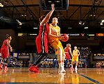 BROOKINGS, SD - NOVEMBER 12:  Clarissa Ober #21 from South Dakota State University takes the ball to the basket against Gwen Adams #44 from Southern Illinois Edwardsville at Frost Arena November 13, 2016 in Brookings, South Dakota. (Photo by Dave Eggen/Inertia)