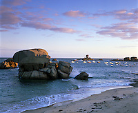 France, Brittany, Tregastel Plage: Dawn,  view along beach on the Pink Granite Coast