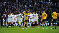 Australia look dejected after losing 20-13 (L-R Matt Toomua, Adam Ashley-Cooper and Tevita Kuridrani of Australia) during the QBE Autumn International match for the Cook Cup between England and Australia at Twickenham on Saturday 2nd November 2013 (Photo by Rob Munro)
