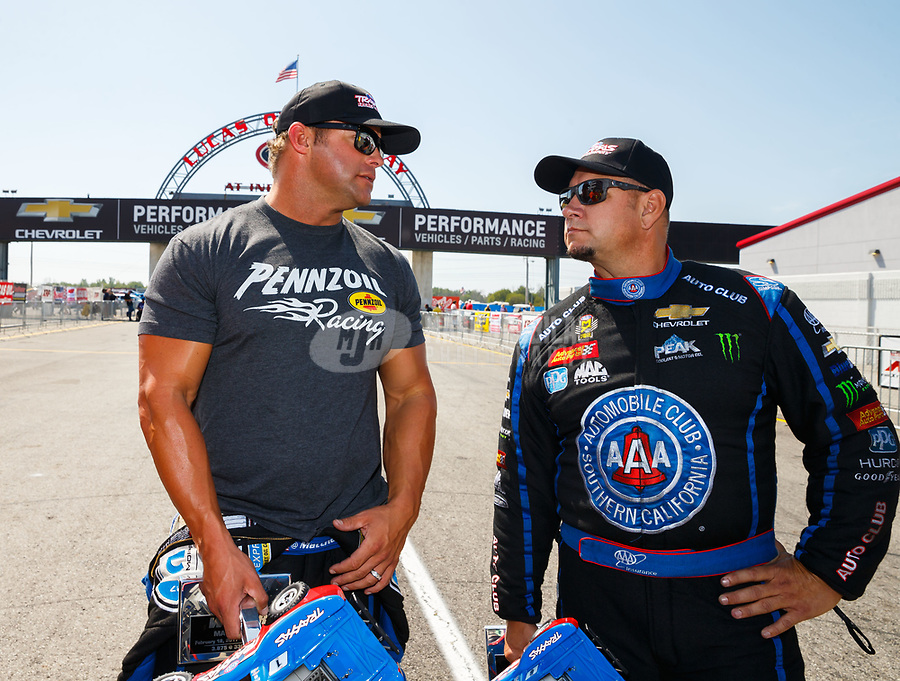 Sep 3, 2017; Clermont, IN, USA; NHRA funny car driver Matt Hagan (left) and  Robert Hight during qualifying for the US Nationals at Lucas Oil Raceway. Mandatory Credit: Mark J. Rebilas-USA TODAY Sports