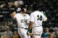 Left fielder Zach Rheams (23) of the Columbia Fireflies is greeted by Jose Brizuela (20) after scoring a run during a game against the Charleston RiverDogs on Tuesday, August 28, 2018, at Spirit Communications Park in Columbia, South Carolina. Columbia won, 11-2. (Tom Priddy/Four Seam Images)