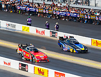 Sep 17, 2017; Concord, NC, USA; NHRA funny car driver Bob Gilbertson (right) alongside Courtney Force during the Carolina Nationals at zMax Dragway. Mandatory Credit: Mark J. Rebilas-USA TODAY Sports
