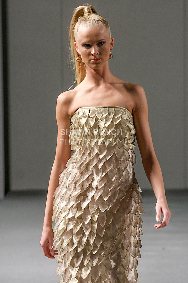 Model walks runway in an outfit from the Joseph Domingo collection, during Couture Fashion Week Spring 2013 in NYC, on September 16, 2012.