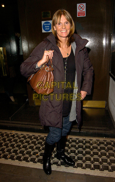 "GWYNETH STRONG.The ""Dealer's Choice"" press night, Trafalgar Studios theatre, London, England..December 11th, 2007.full length brown coat jacket jeans denim tucked into black boots leather bag purse .CAP/CAN.©Can Nguyen/Capital Pictures"
