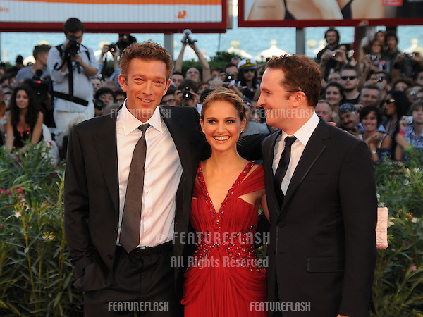 Vincent Cassel, Natalie Portman and Darren Aronofsky at the Black Swan premiere during the 67th annual Venice Film Festival..September 1, 2010  Venice, IT.Picture: Anne-Marie Michel / Featureflash