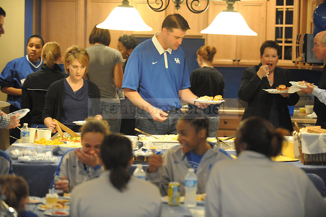 UK head coach Matthew Mitchell and the entire time eat before the Women's Basketball Selection Show at UK head coach Matthew Mitchell's house in Lexington, Ky., on 3/12/12. Photo by Mike Weaver | Staff