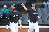 Bobby Seymour (3) of the Wake Forest Demon Deacons points to teammate Chris Lanzilli (not pictured) after scoring a run during the game against the Notre Dame Fighting Irish at David F. Couch Ballpark on March 10, 2019 in  Winston-Salem, North Carolina. The Fighting Irish defeated the Demon Deacons 8-7 in 10 innings in game two of a double-header. (Brian Westerholt/Four Seam Images)