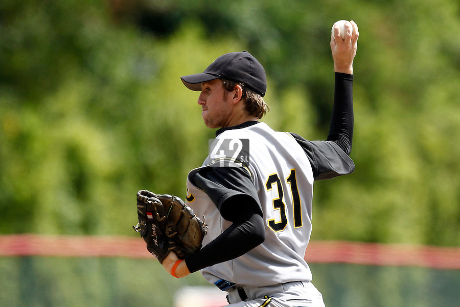 14 July 2011: Starting pitcher Aurelien Leroy of Pessac Pantheres pitches against Senart during the 2011 Challenge de France match won 12-9 by the Senart Templiers over Pessac Pantheres, at Stade Pierre Rolland, in Rouen, France.