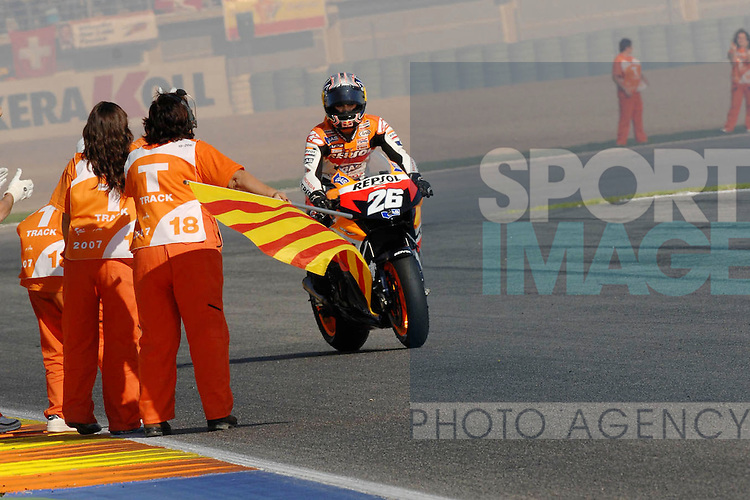 Daniel Pedrosa celebrates winning the Valencia MotoGP