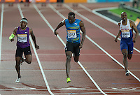 Usain BOLT (Centre) of Jamaica (Men's 100m) crosses the line to win the final during the Sainsburys Anniversary Games Athletics Event at the Olympic Park, London, England on 24 July 2015. Photo by Andy Rowland.