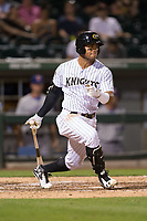 Yoan Moncada (10) of the Charlotte Knights follows through on his swing against the Durham Bulls at BB&T BallPark on May 15, 2017 in Charlotte, North Carolina. The Knights defeated the Bulls 6-4.  (Brian Westerholt/Four Seam Images)