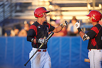 Batavia Muckdogs designated hitter Branden Berry (35) fist bumps J.J. Gould (49) after hitting a home run during a game against the Hudson Valley Renegades on August 2, 2016 at Dwyer Stadium in Batavia, New York.  Batavia defeated Hudson Valley 2-1. (Mike Janes/Four Seam Images)