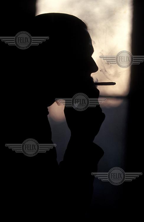 Smoking a cannabis joint (marijuana).