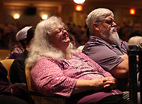 Susan Bro, mother to Heather Heyer, becomes emotional next to her husband Kim, right, during a memorial for her daughter Wed., August 16, 2017, at the Paramount Theater in Charlottesville, Va. Heyer was killed the previous weekend when a vehicle drove into a crowd of counter-protestors after the Unite The Right rally. Photo/Andrew Shurtleff