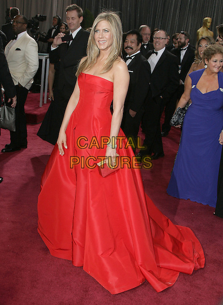 Jennifer Aniston (wearing Valentino).85th Annual Academy Awards held at the Dolby Theatre at Hollywood & Highland Center, Hollywood, California, USA..February 24th, 2013.oscars full length red strapless dress gown silver clutch bag .CAP/ADM.©AdMedia/Capital Pictures.