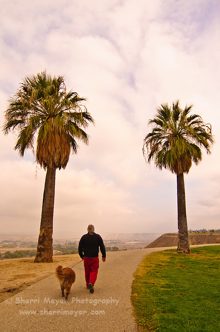 Man walking his dog at Panorama Park, Bakersfield, California.