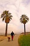 Man walking his dog at Panorama Park, Bakersfield, California.